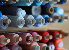 A big amount of spools with colorful threads Royalty Free Stock Photo