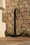 Big anchor placed near the old wall malta. Mellieha Royalty Free Stock Image