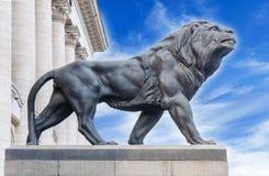 Big ancient archeology statue of lion Stock Photos