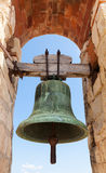 Big ancient bell in fortress of Calafell, Spain Royalty Free Stock Images