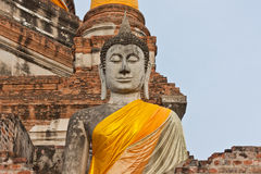 The big ancient buddha statue in ruined old temple Stock Images