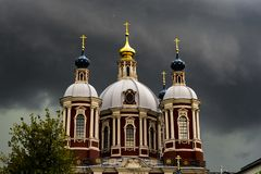 Big ancient church against dark cloudy sky during severe storm stock photos
