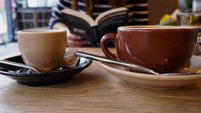 Free Big And Small Cup Of Coffee With Book Lover Royalty Free Stock Photos - 180019858