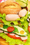 Big appetizing fast food baguette sandwich with lettuce, tomato Stock Photos