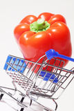 Big appetizing pepper in shopping cart Royalty Free Stock Photography