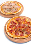 Big appetizing pizza on a wooden tablet. Thinly sliced pepperoni is a popular pizza topping in American-style pizzerias royalty free stock image