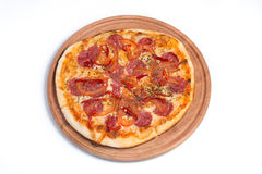 Big appetizing pizza on a wooden tablet stock images