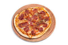 Big appetizing pizza on a wooden tablet stock image