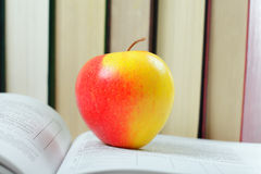 Big apple on book Royalty Free Stock Image