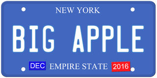 Big Apple New York License Plate. An imitation New York license plate with December 2016 stickers and BIG APPLE written on it making a great concept.  Words on Royalty Free Stock Image