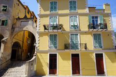 Big arch and building. Big arch and favade of building in Menton, France Stock Photo