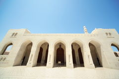 Big arcs of building inside Grand Mosque in Oman. Royalty Free Stock Photography