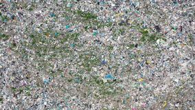 Big area of garbage dump aerial shot fly bottom up. Large area of waste garbage dump from unprocessed plastic and cellophane. Aerial flying from bottom to top stock footage