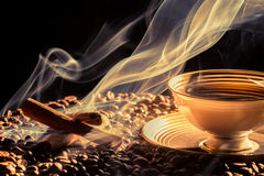 Big aroma of coffee from little cup royalty free stock image
