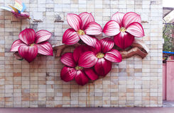 Big artificial red flowers made of cloth on wall Stock Images