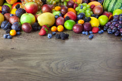 Big assortment of Fresh Organic Fruits, border composition Stock Images