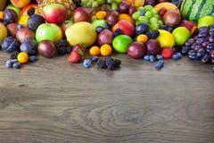 Big assortment of Fresh Organic Fruits, border composition stock images