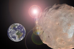 Big Asteroid Closing to the Earth Planet. Apocalypse Concept. Elements of this image furnished by NASA Stock Images