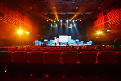 Big auditorium with illuminated scene Stock Photo