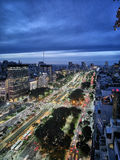 Big avenue at night. Lots of traffic making its way through the widest avenue in the world, the Avenida 9 de Julio in Buenos Aires, Argentina. Lighttrails seen royalty free stock image