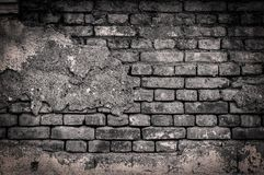 Big B&W wall of old cracked brick background. Close royalty free stock photos