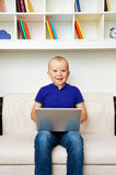 Big baby with laptop Stock Images