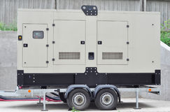 Big Backup Diesel Mobile Generator for Office Building Connected to th. Big Backup  Mobile Generator for Office Building Connected to the Control Panel with Royalty Free Stock Photo