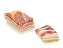 Big Bacon Part and Slices in Front Left Royalty Free Stock Image