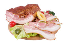 Big bacon and a thiny slices of it Royalty Free Stock Photo