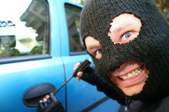 Big Bad Burglar. Is smiling at you evil cause he is stealing your car Stock Images