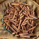 Big bag with cinnamon sticks Stock Images