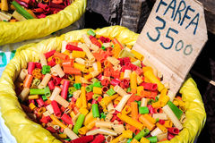 Big bags with colorful pasta for sale on a market Royalty Free Stock Image