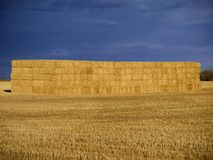 Big Bales of Hay in Stack Against a Dark Sky in Alberta Canada royalty free stock photo