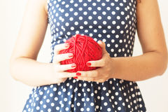 Big ball of red wool in the hands Royalty Free Stock Images