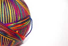 Big ball of Yarn. This is a large ball of multi colored yarn with a white background Stock Images