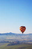 Big balloon flies over rural houses Royalty Free Stock Image