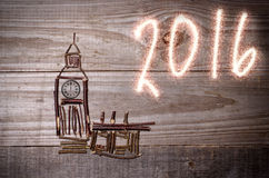 Big Ban arranged from wooden sticks, clock showing 12 o'clock. Sparkly 2016 written on grey background. London Europe Stock Image