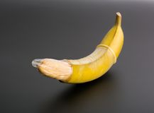 Big banana with condom Royalty Free Stock Photography
