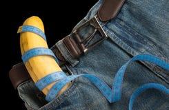 Big Banana like the penis in the men's jeans, centimeter Stock Photos