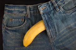 Big Banana and men's jeans, like the penis Royalty Free Stock Photos