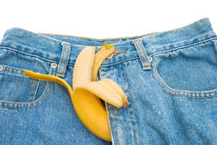Big banana sticks out of mens jeans like penis as potency concept Stock Photos