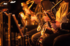 Big Band saxophone section. A candid view along the saxophone section of a big band in concert Royalty Free Stock Images