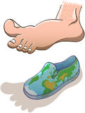 Big barefoot hovering over a small world map shoe Royalty Free Stock Photo