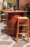 Barrels used as tables in a restaurants in the streets stock photos
