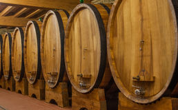 Big barrels with wine in winery cellar Royalty Free Stock Photos