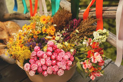 Big basket of different flowers with ribbons Stock Images