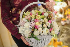 Big basket with white light flowers bouquet Royalty Free Stock Images