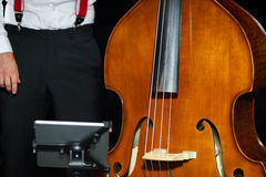 Big bass viol on the scene before the concert. Music instruments Royalty Free Stock Photos