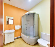Big bathroom with a shower cabin. A toilet and a sink stock photography