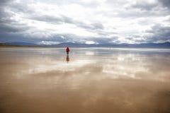 Big beach with woman walking Royalty Free Stock Photo
